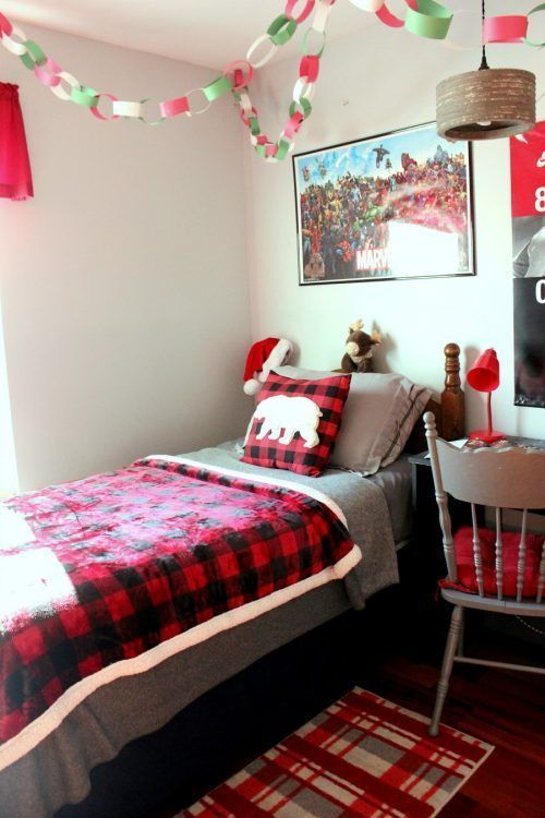 plaid bedding and a rug, a colorful Christmas chain garland will bring a holiday feel to your kids' room easily