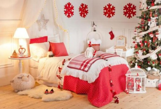 a bright and welcoming neutral and red Christmas kid's room with red pillows, blankets, snowflakes and Christmas tree decor in red and white is very lovely