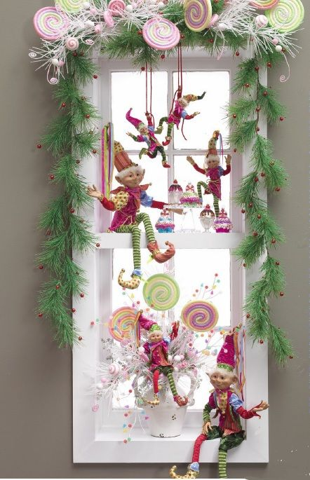 whimsical Christmas window decor with faux fir, verries, elves and candies is a lovely and fun idea to rock