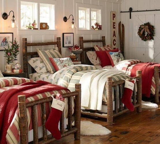 bright Christmassy blankets and bedding, mini Christmas trees with red ornaments, some wreaths to turn on a holiday feel in the kids' room