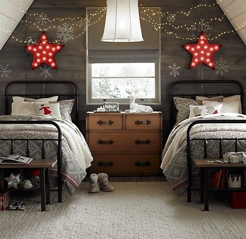 star marquee lights over the beds, lights and snowflake decals are all you need to make the kids' room look very festive and holiday-like