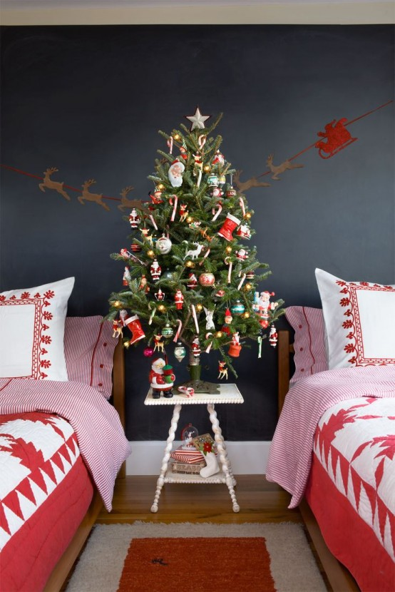 a Christmas tree decorated with bright ornaments and star banners and garlands is a lovely idea to rock in your kids' room, add holiday printed bedding