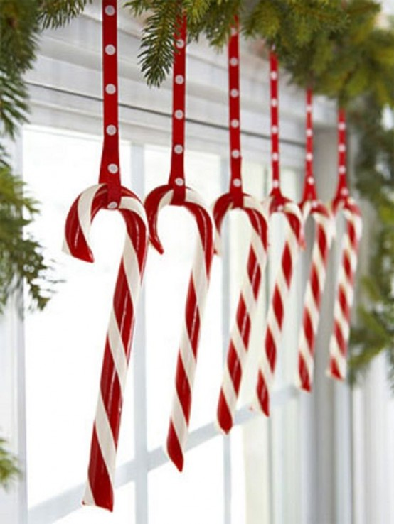 red and white candy canes and ribbons and fir branches to decorate a window in your kids' room