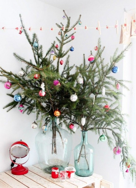bottles with fir branches and colorful ornaments will bring a festive feel to any room, you don't need a whole tree