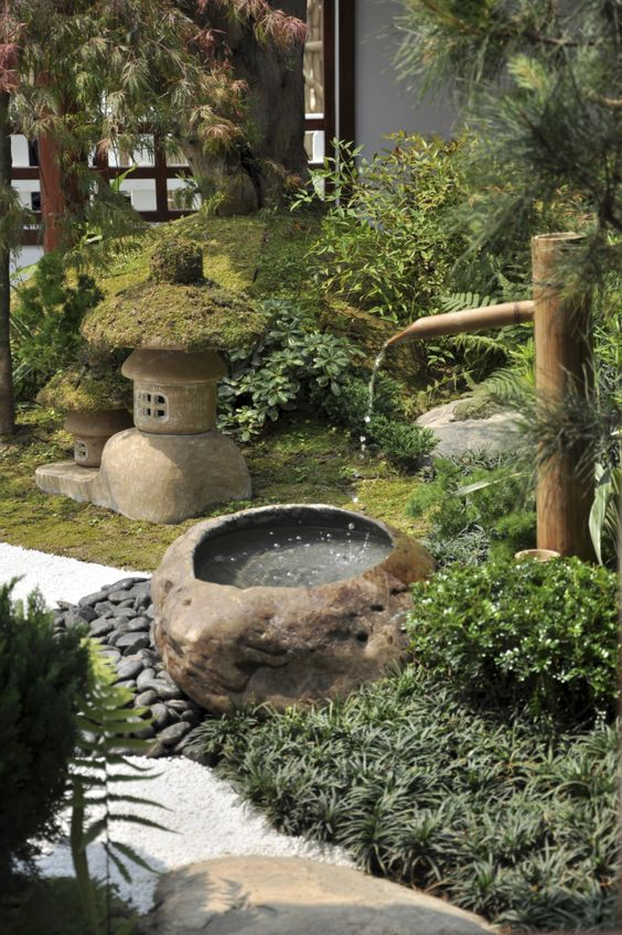 grass and greenery, pebbles, a stone and bamboo fountain, a stone and moss lantern for creating a lovely Japanese space