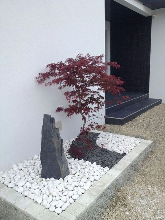 black and white pebbles, a large rock and a red maple mini tree at the entrance will make the space look wow