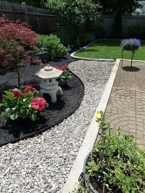 black and white pebbles, bold blooms, shrubs and mini maples for an elegant Japanese front yard