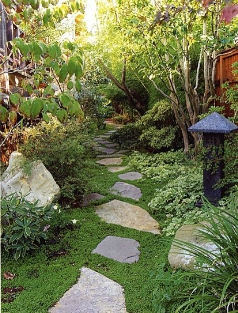 green grass, mini shrubs, trees and a tone lantern in Japanese style will make the front yard look very zen-like