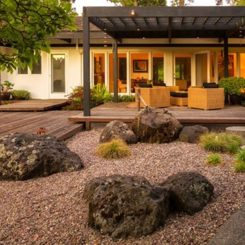 pebbles with large rocks covered with moss and a bamboo fountain will make the front yard look very cool and very Asian-like