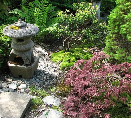 moss, rocks, pebbles, shrubs, small trees and a stone Japanese lantern for a lovely Japanese garden