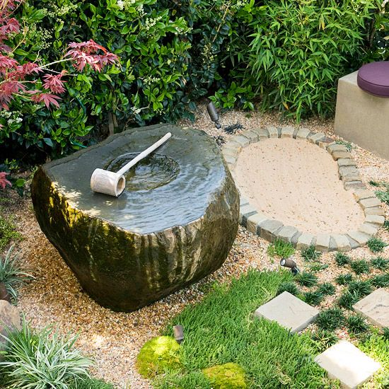 grass, pebbles, bricks and a stone fountain bowl with a wooden scoop for a casual and relaxed Japanese feel in the garden