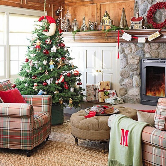a rustic living room with bold Christmas decor - a red pillow, a berry wreath and a Christmas tree with catchy red and white ornaments plus a red garland with bold touches