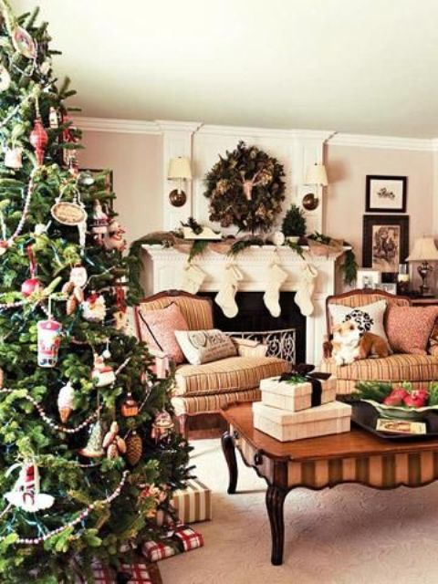 a row of stockings, a fir garland, a lush fir wreath, a Christmas tree with various vintage-inspired ornaments for creating a mood