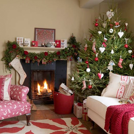 a Christmas tree with red and white ornaments, a garland with red blooms and gift boxes make the space feel Scandinavian and holiday-like