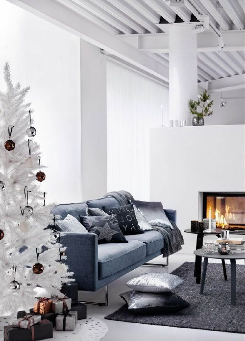 a minimalist living room with a white Christmas tree decorated only with brown and silver sequin ornaments - that's all you need in such a space to create a mood