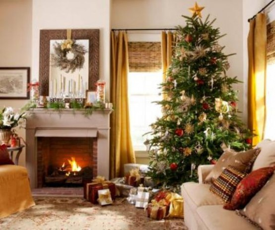 a Christmas tree with lights, red and gold ornaments, a fir garland, candles, a branch wreath and lots of gifts under the tree