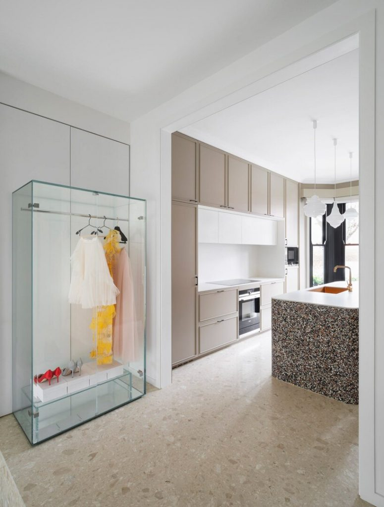 a super stylish and super sall closet near a kitchen