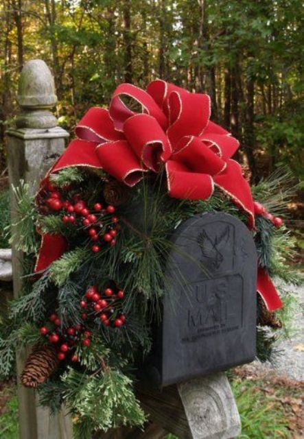 decorate your mail box with a red bow, fir branches, berries and pinecones for a cozy rustic outdoor feel