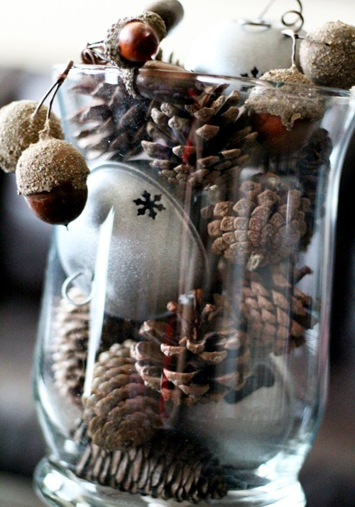 A Glass With Pinecones, Oversized Bells And Acorns Is An Easy And Cool Christmas Centerpiece Or Just Decoration To Rock