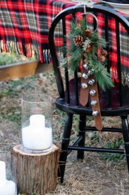 A Lovely Christmas Hanging Of Silver Bells, Leather Belts, Fir Branches And Pinecones Is A Lovely Decoration To Rock