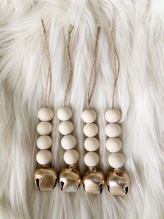 Christmas Ornaments Of Wooden Beads And Gold Bells Can Be Easily Diyed And They Look Cool