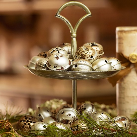A Metallic Stand With Rusty Gold Bells And Fir Branches Is A Pretty Christmas Decoration To Make, Can Be Used As A Centerpiece, Too