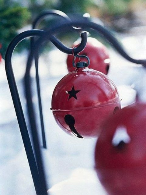 Hang Oversized Christmas Bells In Red On Holders To Infuse Your Outdoor Spaces With A Christmas Feel