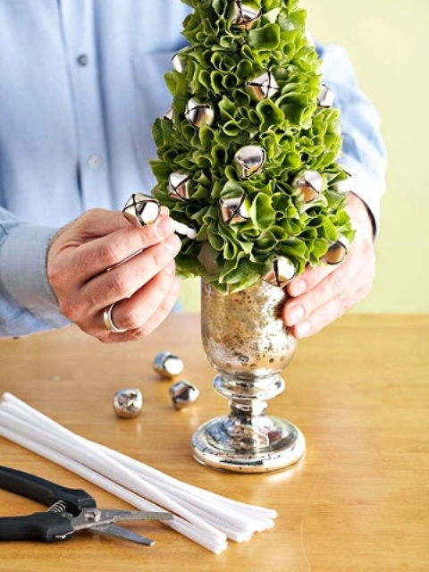 A Greenery Tabletop Christmas Tree In A Mercury Glass And With Lots Of Silver Bells Is A Refined Winter Holiday Decoration