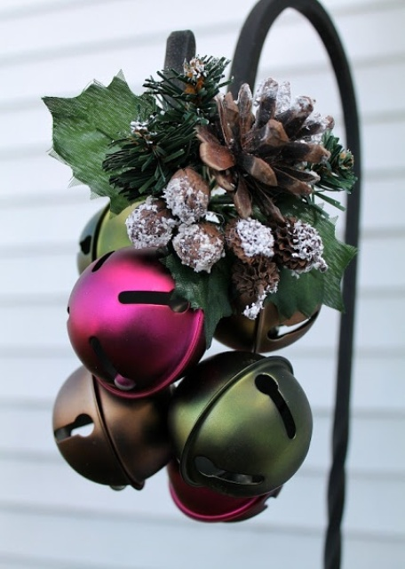 An Outdoor Christmas Decoration Of Pink, Green And Brown Bells, Snowy Pinecones, Foliage Is Pretty, Bold And Very Modern