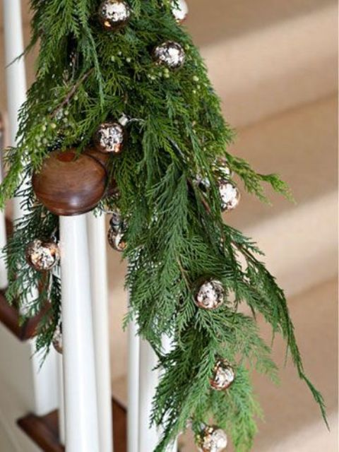 Railing Decorated With Fir Branches And Silver Bells For Christmas - Natural And Traditional At The Same Time