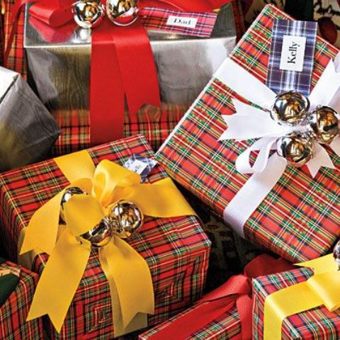 Christmas Gifts Wrapped In Plaid Paper, With Yellow And White Ribbon And Silver Bells On Top Are Amazing For Christmas