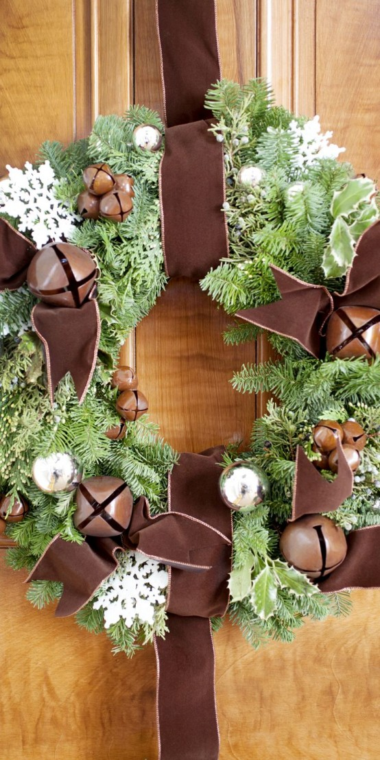 A Chic Fir Wreath With Bells, Silver Ornaments, White Snowflakes And Oversized Brown Bells And Brown Ribbon Is A Lovely And Chic Idea For The Holidays