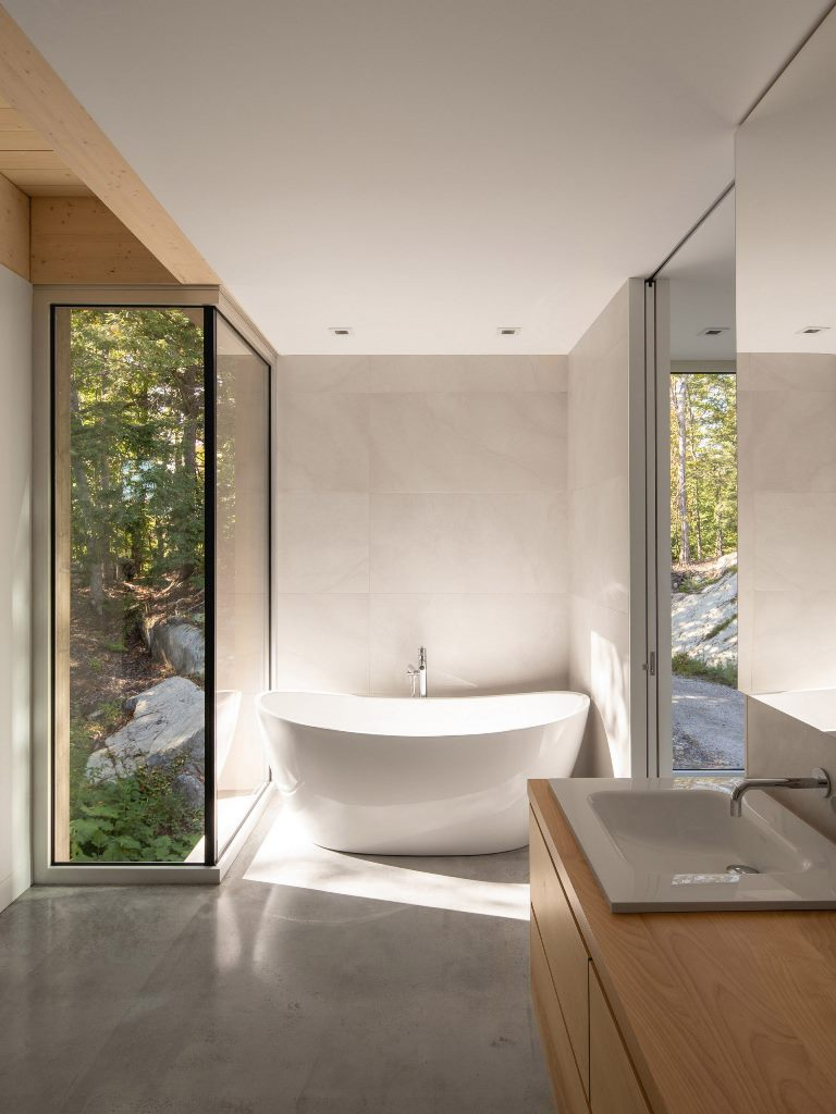 The master bathroom features a bath tub with a view