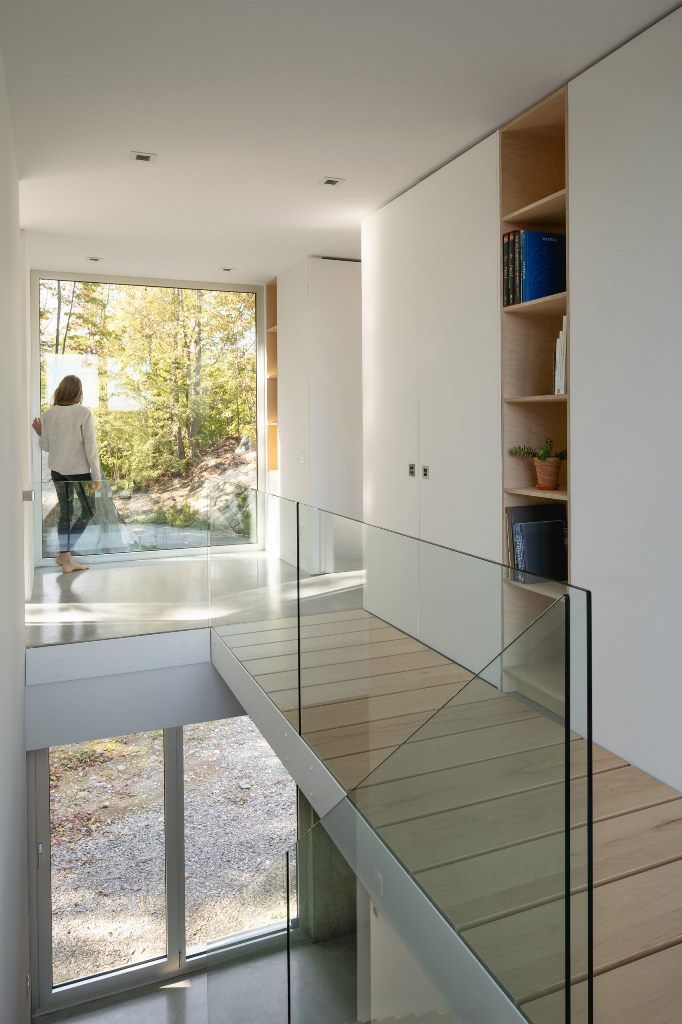 A Staircase Separates The Living Spaces From The Master Bedroom