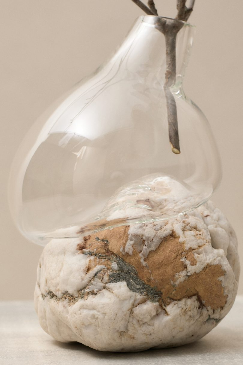 closeup glass vessel and rock