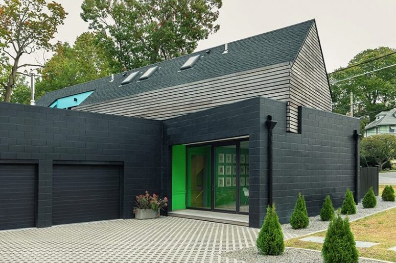 This stylish modern house is built in NYC suburbs and its facade is inspired by 1930s houses that surround it